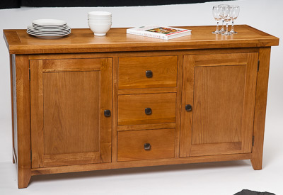 Example of oak sideboard furniture photographed on a white background before whitening the background in Photoshop